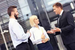 Business people having discussion outside modern building