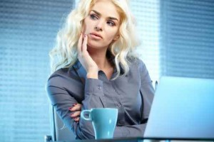 Blonde pretty business woman working at her office. She is very